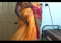 desi  indian horny tamil telugu kannada malayalam hindi cheating wife vanitha wearing orange colour saree  showing big boobs and shaved pussy fluster hard boobs fluster nip rubbing pussy wrong